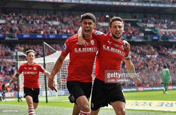 Ashley Fletcher of Barnsley FC celebrates scoring the first goal during the Sky Bet League One Play Off Final between Barnsley and Millwall at...