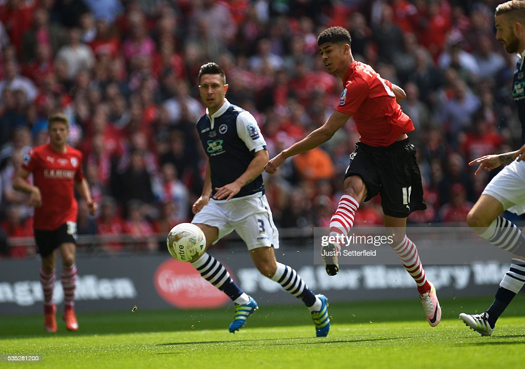 Ashley Fletcher of Barnsley FC scores the first goal during the Sky Bet League One Play Off Final between Barnsley and Millwall at Wembley Stadium on May 29, 2016 in London, England.