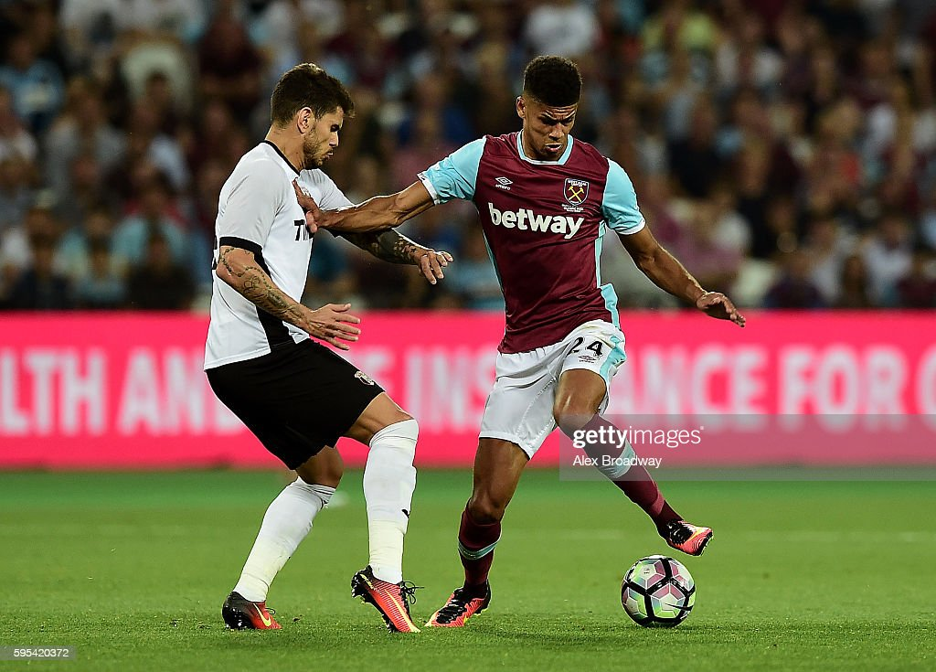 Ashley Fletcher of West Ham holds off pressure from Fabricio Silva Dornellas of FC Astra Giurgiu during the UEFA Europa League match between West Ham United and FC Astra Giurgiu at the Olympic Stadium on August 27, 2016 in London, England.