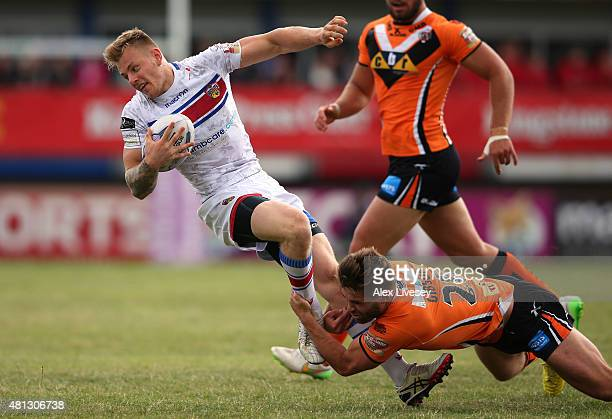 Ashley Gibson of Castleford Tigers tackles Tom Johnstone of Wakefield Trinity Wildcats during the First Utility Super League match between Wakefield...