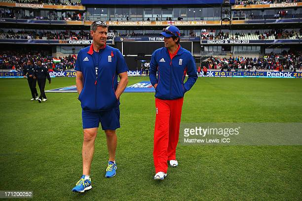 Ashley Giles and Alastair Cook of England go out to inspect the pitch during the ICC Champions Trophy Final between England and India at Edgbaston on...