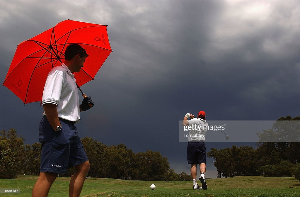 Ashley Giles of England looks on as the storm comes during the Vodafone sponsored Golf day at the Vines Golf course Perth on October 27 2002