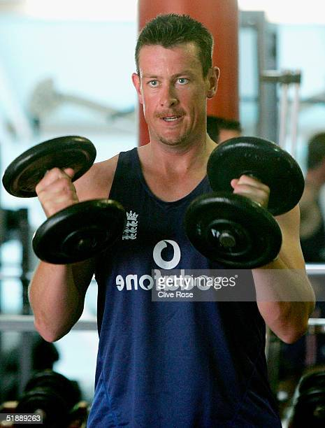 Ashley Giles of England watches his reflection as he uses weights in the gym during a training session ahead of the second Test Match between South...