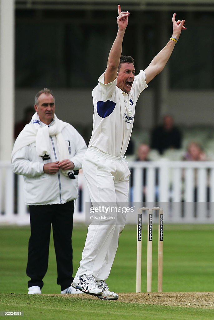 Ashley Giles of Warwickshire celebrates dismissing Alex Wharf of Glamorgan during the Frizzell County Championship match between Warwickshire and...