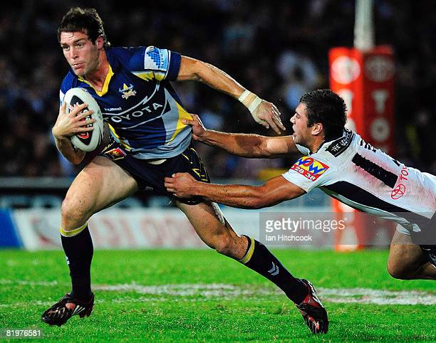 Ashley Graham of the Cowboys looks to get past Joel Moon of the Broncos during the round 19 NRL match between the North Queensland Cowboys and the...