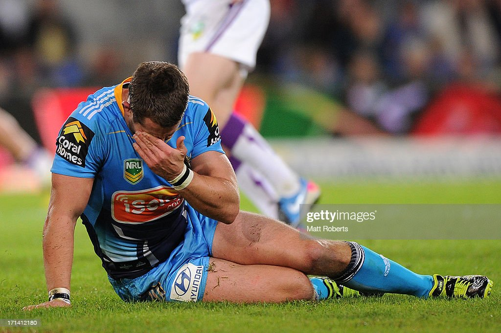 Ashley Harrison of the Titans puts his hand to his face after making a tackle during the round 15 NRL match between the Gold Coast Titans and the Melbourne Storm at Skilled Park on June 24, 2013 on the Gold Coast, Australia.