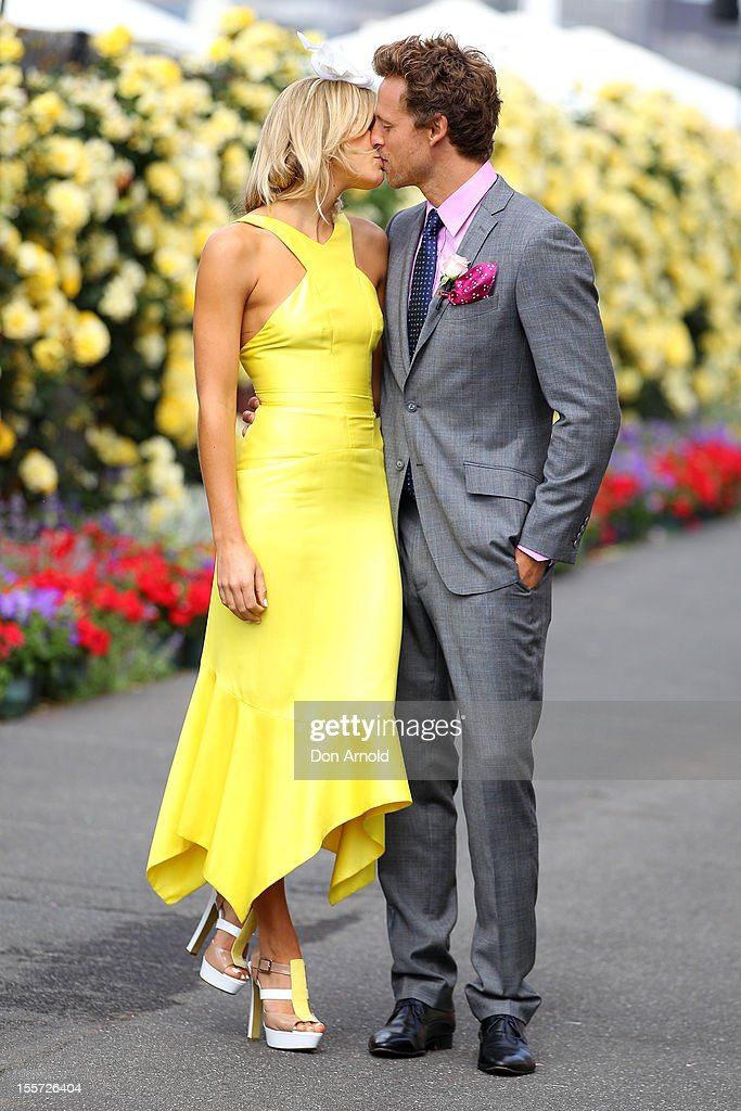 Ashley Hart and Buck Palmer kiss in the birdcage on Crown Oaks Day at Flemington Racecourse on November 8, 2012 in Melbourne, Australia.