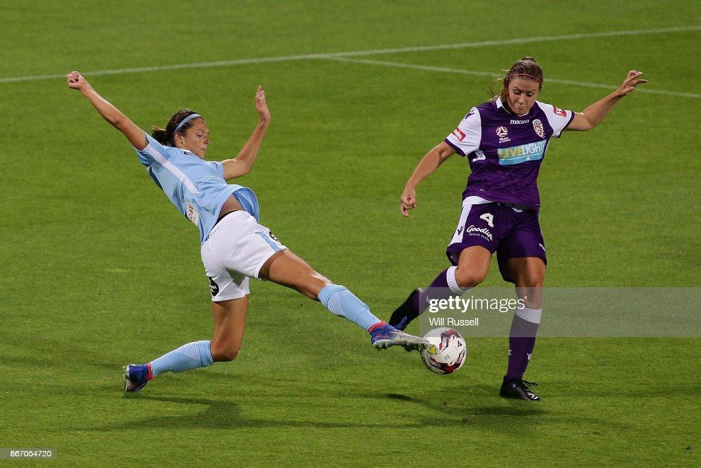 Ashley Hatch of Melbourne City competes for the ball against Natasha Rigby of the Glory during the round one W-League match between the Perth Glory and Melbourne City FC at nib Stadium on October 27, 2017 in Perth, Australia.