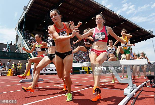 Ashley Higginson and Shalaya Kipp nearly fall as they compete in the Women's 3000 Meter Steeplechase final during day three of the 2015 USA Outdoor...