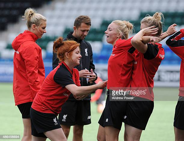 Ashley Hodson Kate Longhurst and Martha Harris of Liverpool Ladies in action during a training session at Select Security Stadium on September 4 2015...