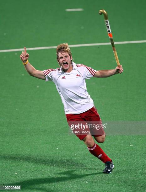 Ashley Jackson of England celebrates scoring a goal during the semi final hockey match between India and England at Major Dhyan Chand National...