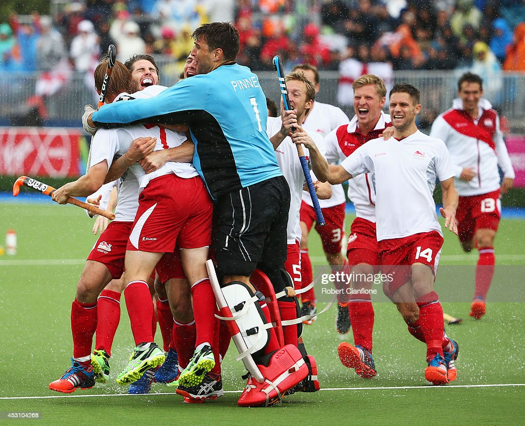 Ashley Jackson of England (7) is congratulated by team mates after his decisive penalty stroke to win bronze after a shoot out in the bronze medal match between New Zealand and England at Glasgow National Hockey Centre during day eleven of the Glasgow 2014 Commonwealth Games on August 3, 2014 in Glasgow, United Kingdom.