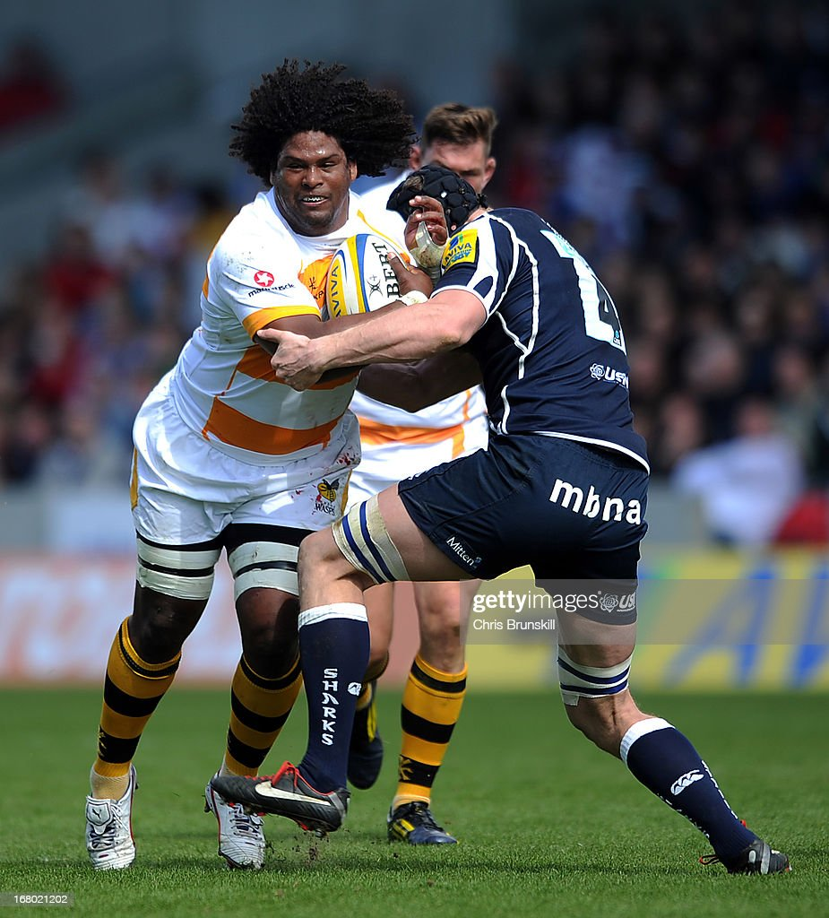 Ashley Johnson of London Wasps is tackled by Kearnan Myall of Sale Sharks during the Aviva Premiership match between Sale Sharks and London Wasps at the Salford City Stadium on May 04, 2013 in Salford, England.