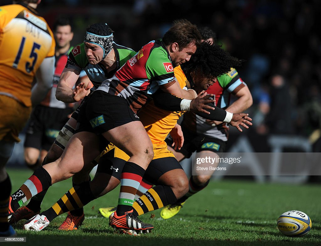 Ashley Johnson of London Wasps is tackled by Paul Doran-Jones during the Aviva Premiership match between Harlequins and London Wasps at Twickenham Stoop on February 9, 2014 in London, England.