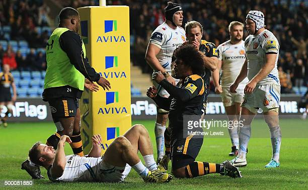 Ashley Johnson of Wasps celebrates his try during the Aviva Premiership match between Wasps and Exeter Chiefs at the Ricoh Arena on December 4 2015...