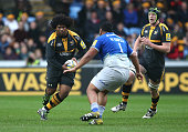 Ashley Johnson of Wasps charges upfield during the Aviva Premiership match between Wasps and Saracens at The Ricoh Arena on December 27 2015 in...