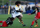 Ashley Johnson of Wasps is tackled by Brad Barritt of Saracens during the Aviva Premiership match between Saracens and Wasps at Allianz Park on...