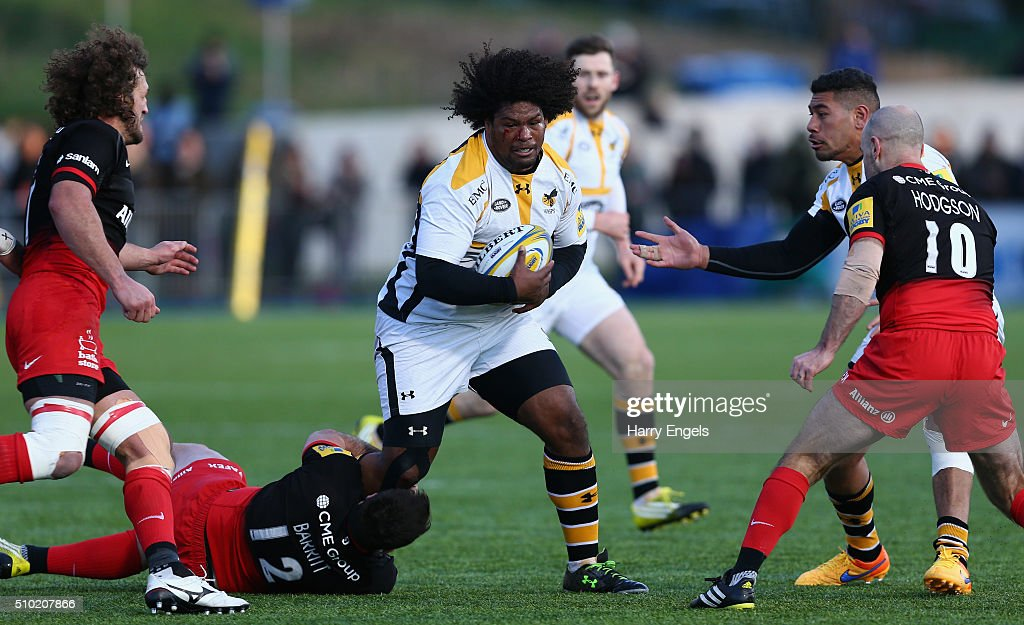 <a gi-track='captionPersonalityLinkClicked' href=/galleries/search?phrase=Ashley+Johnson+-+Rugby+Union+Player&family=editorial&specificpeople=15285872 ng-click='$event.stopPropagation()'>Ashley Johnson</a> of Wasps is tackled by Brad Barritt of Saracens during the Aviva Premiership match between Saracens and Wasps at Allianz Park on February 14, 2016 in London, United Kingdom.