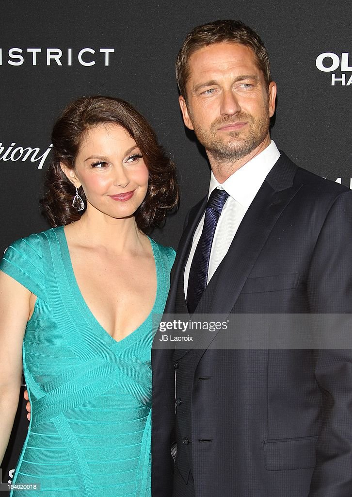 <a gi-track='captionPersonalityLinkClicked' href=/galleries/search?phrase=Ashley+Judd&family=editorial&specificpeople=171188 ng-click='$event.stopPropagation()'>Ashley Judd</a> and Gerard Buttler attend the 'Olympus Has Fallen' Los Angeles Premiere held at ArcLight Cinemas Cinerama Dome on March 18, 2013 in Hollywood, California.