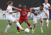Ashley Lawrence of Canada battles for the ball against Jill Scott of England during their Women's International Friendly match on May 29 2015 at Tim...