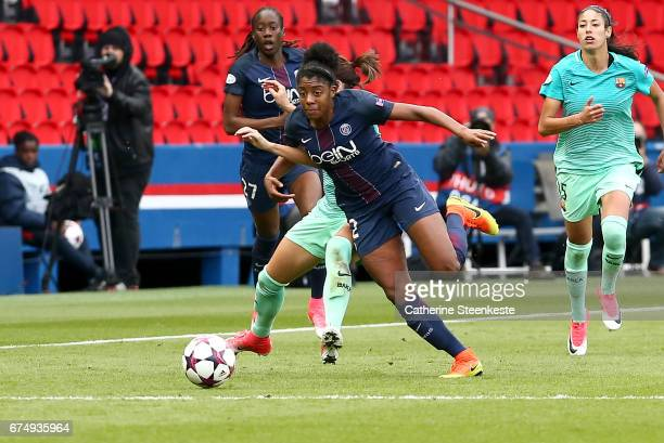Ashley Lawrence of Paris SaintGermain is trying to control the ball against Jennifer Hermoso of FC Barcelona during the Women's Champions League...