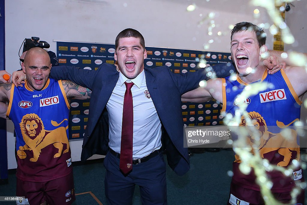 Ashley McGrath Jonathan Brown and Justin Clarke of the Lions sing the team song after winning the round 15 AFL match between the Brisbane Lions and...