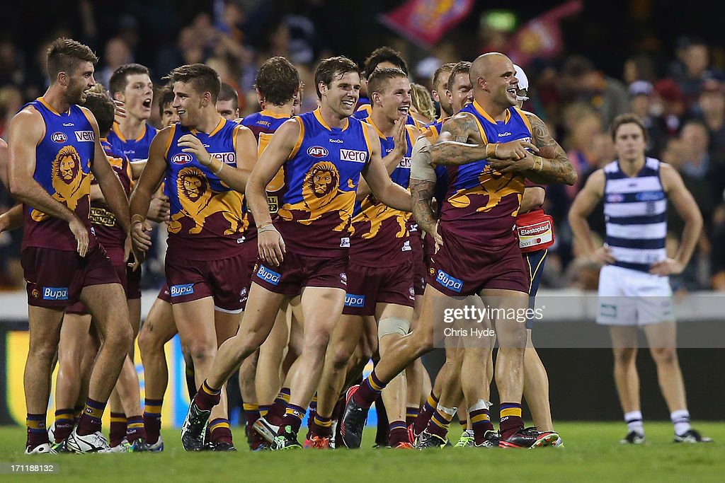 <a gi-track='captionPersonalityLinkClicked' href=/galleries/search?phrase=Ashley+McGrath&family=editorial&specificpeople=242768 ng-click='$event.stopPropagation()'>Ashley McGrath</a> of the Lions celebrates with team mates after kicking the winning goal during the round 13 AFL match between the Brisbane Lions and the Geelong Cats at The Gabba on June 23, 2013 in Brisbane, Australia.