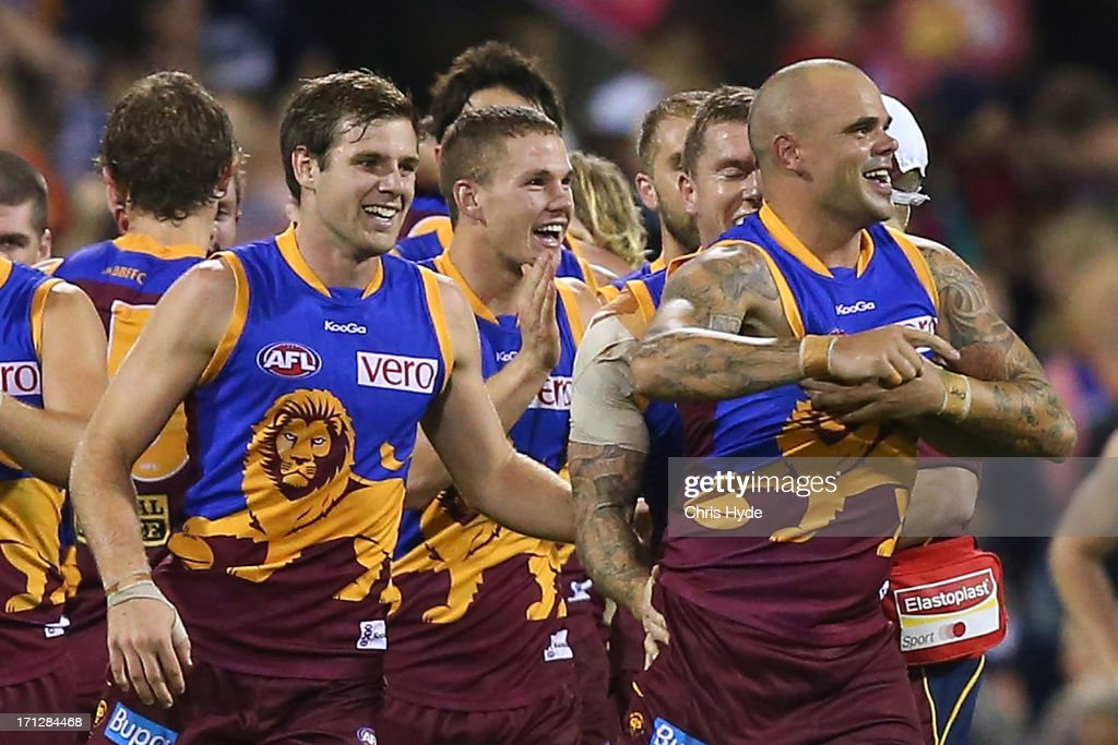 <a gi-track='captionPersonalityLinkClicked' href=/galleries/search?phrase=Ashley+McGrath&family=editorial&specificpeople=242768 ng-click='$event.stopPropagation()'>Ashley McGrath</a> (R) of the Lions celebrates with team mates after kicking the winning goal during the round 13 AFL match between the Brisbane Lions and the Geelong Cats at The Gabba on June 23, 2013 in Brisbane, Australia.