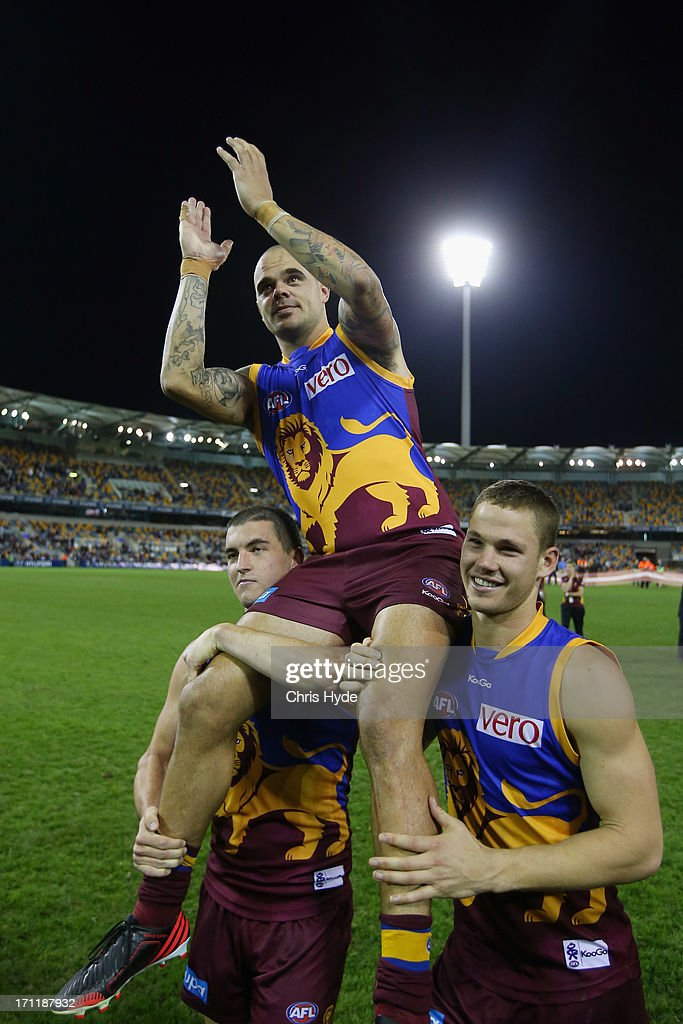 <a gi-track='captionPersonalityLinkClicked' href=/galleries/search?phrase=Ashley+McGrath&family=editorial&specificpeople=242768 ng-click='$event.stopPropagation()'>Ashley McGrath</a> of the Lions is chaired off by team mates Tom Rockcliff and Jack Redden after his 200th game during the round 13 AFL match between the Brisbane Lions and the Geelong Cats at The Gabba on June 23, 2013 in Brisbane, Australia.