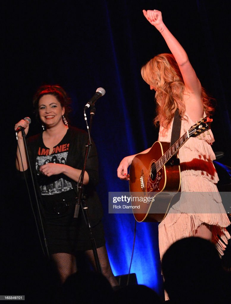 Ashley Monroe (right) is joined by her Pistol Annies band mate, Angaleena Presley during the Ashley Monroe Album Release Party for ' Like a Rose' at 3rd & Lindsley on March 7, 2013 in Nashville, Tennessee.