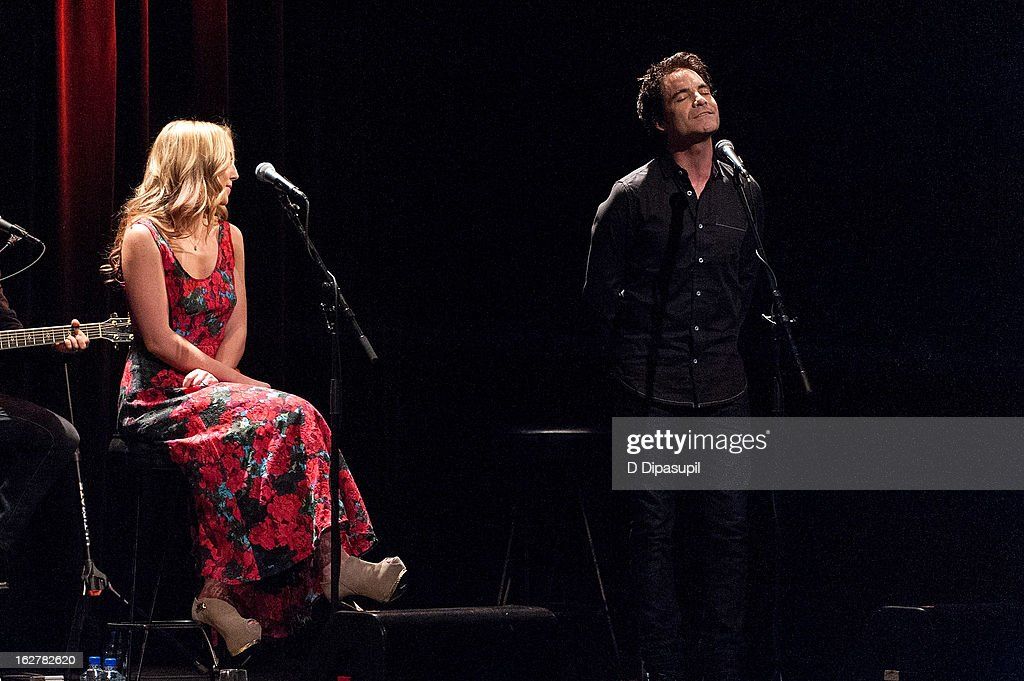 Ashley Monroe (L) looks on as Pat Monahan performs on stage during the All For The Hall New York concert benefiting the Country Music Hall Of Fame at Best Buy Theater on February 26, 2013 in New York City.