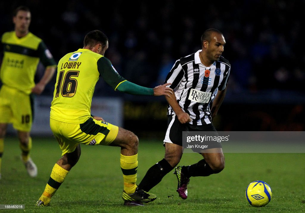 Ashley Nichols of Dorchester Town competes with Jamie Lowry of Plymouth Argyle during the FA Cup with Budweiser 1st Round match between Dorchester Town and Plymouth Argyle at The Avenue Stadium on November 4, 2012 in Dorchester, England.