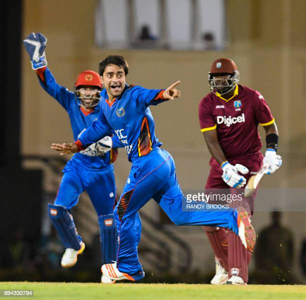 Ashley Nurse of West Indies is dismissed by lbw by Rashid Khan of Afghanistan during the 1st ODI match between West Indies and Afghanistan at Darren...