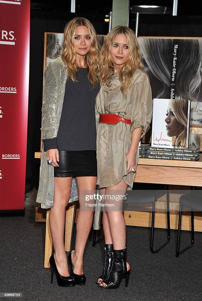 Ashley Olsen (L) and Mary Kate Olsen attend a book signing session for 'Influence' on Novenber 12, 2008 at Borders books store in Westwood, California.