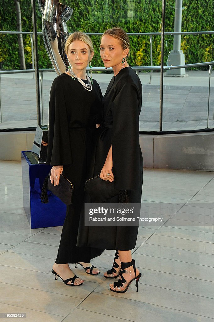 Ashley Olsen and Mary Kate Olsen attends the 2014 CFDA fashion awards at Alice Tully Hall, Lincoln Center on June 2, 2014 in New York City.