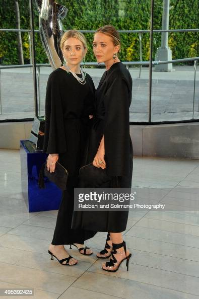 Ashley Olsen and Mary Kate Olsen attends the 2014 CFDA fashion awards at Alice Tully Hall Lincoln Center on June 2 2014 in New York City