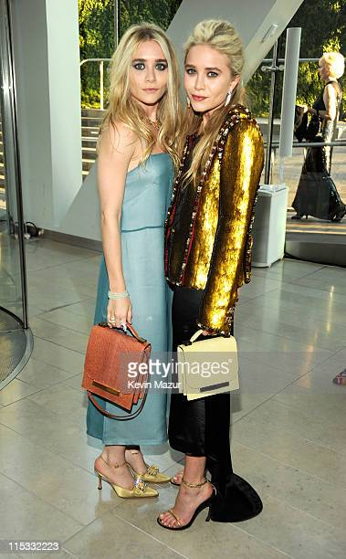 Ashley Olsen and MaryKate Olsen attend the 2011 CFDA Fashion Awards at Alice Tully Hall Lincoln Center on June 6 2011 in New York City