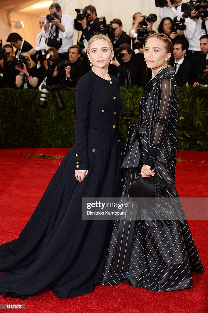 Ashley Olsen (L) and Mary-Kate Olsen attend the 'Charles James: Beyond Fashion' Costume Institute Gala at the Metropolitan Museum of Art on May 5, 2014 in New York City.
