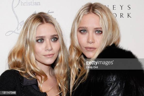 Ashley Olsen and MaryKate Olsen attend the Christian Louboutin Cocktail party at Barneys New York on November 1 2011 in New York City