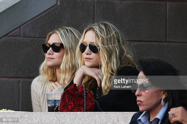 Ashley Olsen and MaryKate Olsen watch the match between Roger Federer of Switzerland and Juan Martin Del Potro of Argentina on day fifteen of the...