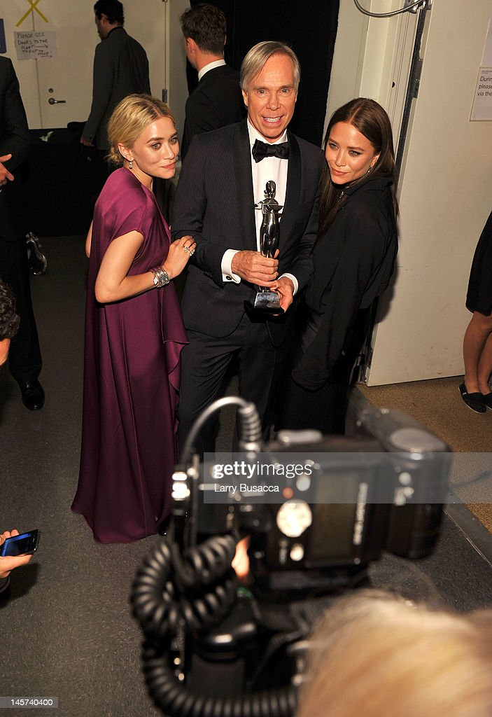 Ashley Olsen, designer Tommy Hilfiger and Mary-Kate Olsen attend the2012 CFDA Fashion Awards at Alice Tully Hall on June 4, 2012 in New York City.