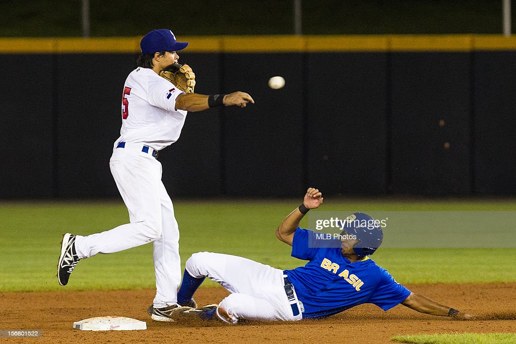 Ashley Ponce #5 of Team Panama turns a double play as Leonardo Reginatto #20 of Team Brazil slides into second base in the bottom of the fifth inning during Game 6 of the Qualifying Round of the World Baseball Classic at Rod Carew National Stadium on Monday, November 19, 2012 in Panama City, Panama.