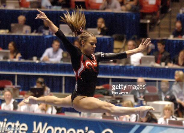 Ashley Postell of Utah flies in the air on the balance beam during the NCAA Women's Gymnastics Championships at the Huntsmann Center in Salt Lake...