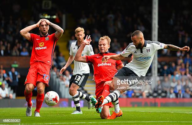 Ashley Richards of Fulham FC clears from Jordan Rhodes of Blackburn during the Sky Bet Football League Championship match between Fulham and...