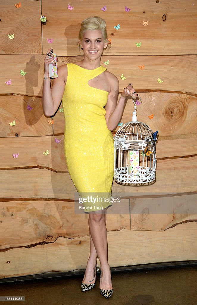 Ashley Roberts attends a photocall to launch her new fragrance 'Ashley by Ashley Roberts' at The Folly on March 12 2014 in London England