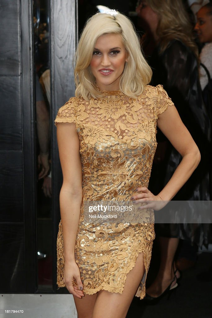 Ashley Roberts attends a photocall to launch the KEY Fashion brand at Vanilla on September 25, 2013 in London, England.