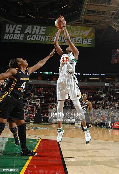 Ashley Robinson of the Seattle Storm shoots against Amber Holt of the Tulsa Shock during the game on August 25 2011 at Key Arena in Seattle...