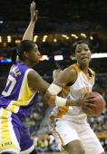 Ashley Robinson of the Tennessee Lady Vols tries to pivot around Treynell Clavelle of the Louisiana State Lady Tigers during the semifinal game of...