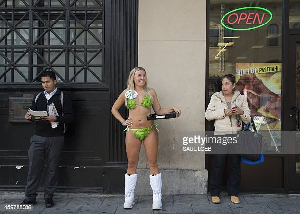 Ashley Rose of PETA dressed in a lettuce bikini and known as a 'Lettuce Lady' hands out free Subway vegan sandwiches to promote eating vegan outside...