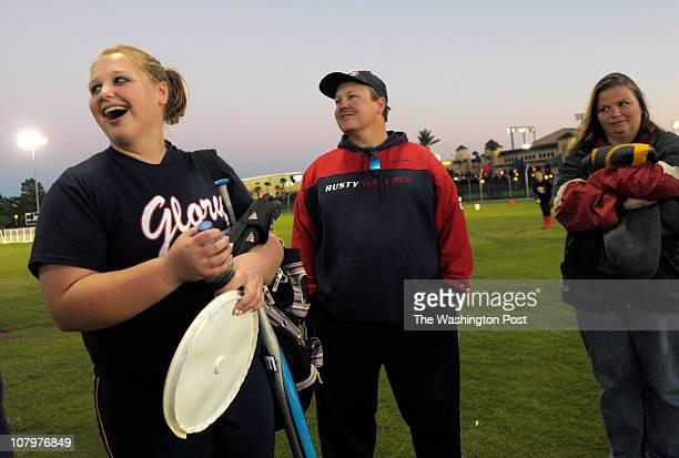 Ashley Runion left shares a laugh with her father Sonny Runion center and mother Shelly Runion before playing in a showcase softball game in Lake...